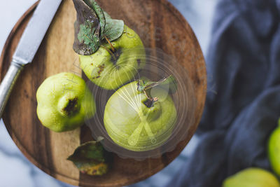 Quince fruit on a chopping board