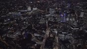 Aerial footage of the City of London lit up at night
