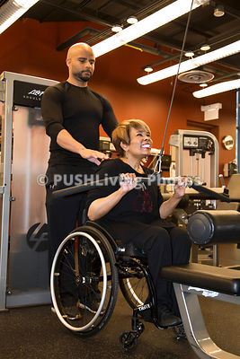 Woman using a wheelchair at the gym