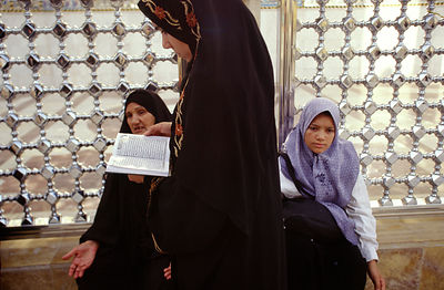 women read at the shrine in Karbala, Iraq