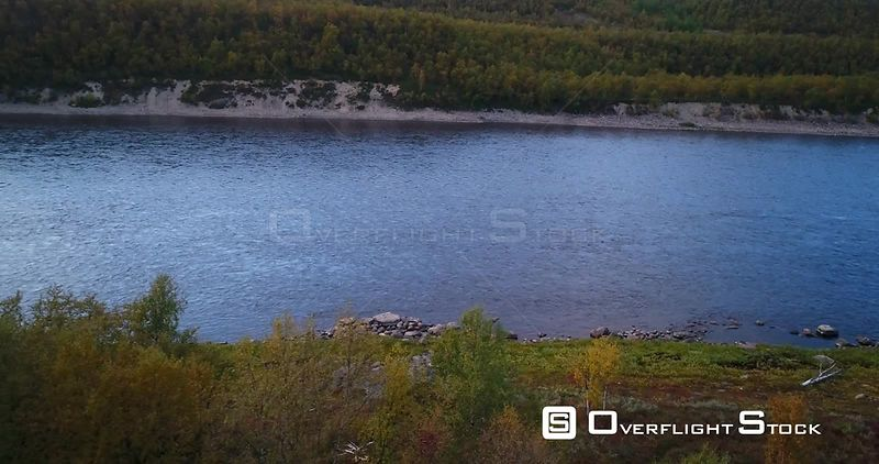 Autumn River, Aerial Tilt View of Tenojoki River at the Border Between Norway and Utsjoki Town, on a Sunny Autumn Evening Daw...
