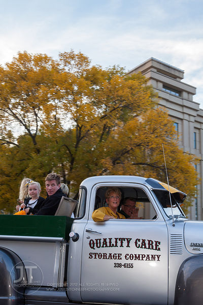 Parade participants pass by on Clinton St during the  University of Iowa homecoming Parade in Iowa City on Friday September 2...