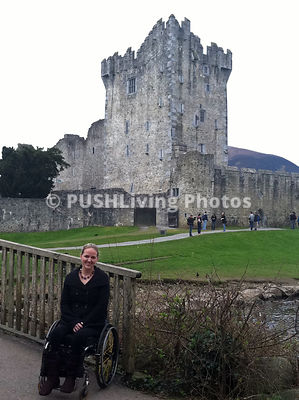 Young female tourist using a wheelchair in Ireland