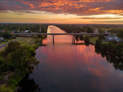 Sunrise and its reflections over the Nepean River, views looking north towards Richmond.  The M4 motorway crosses in the mid ...