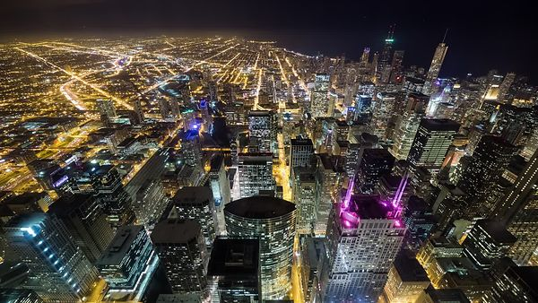 Bird's Eye: Above the Tallest Beacons of Chicago's Abundant Skyline & Expansive City Horizon at Night