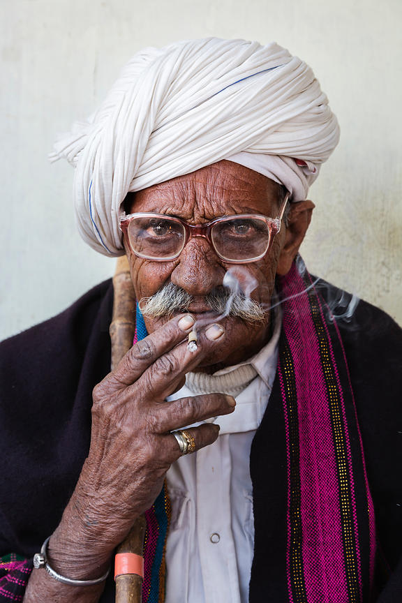 Man with White Turban Smoking a Cigarette