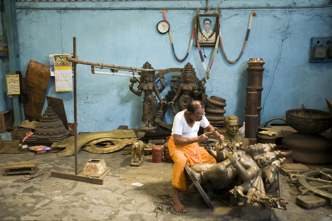 India - Swamimalai - Master craftsman Pranava Stapathy works on a large statue of Hanuman