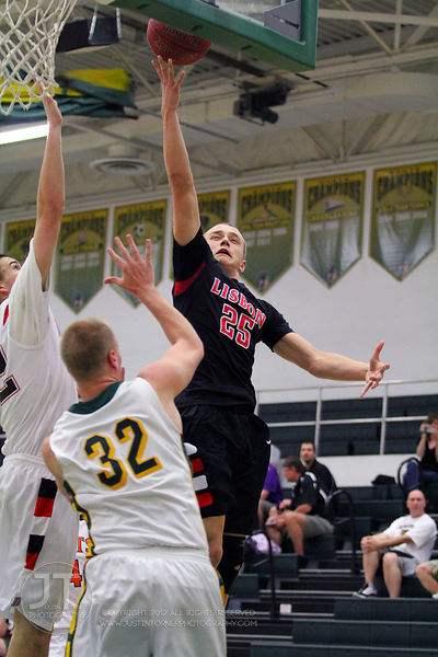 Lisbon's Ben Knake (25) drives to the basket over Eliott Christians (32) in the first half of play. The Northern All-Star tea...