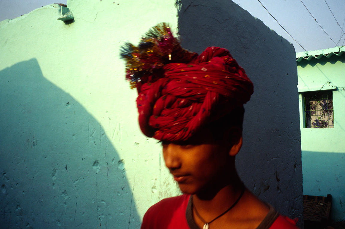 India - New Delhi - A boy walks through Shadipur