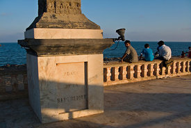 Men sit on the promenade