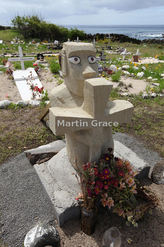 Cemetery at Hanga Roa, Easter Island (Rapa Nui) with grave headstone of both Christian and moai symbology