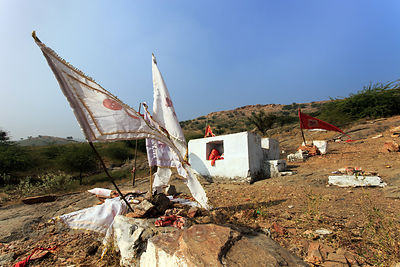 Small temple near an elementary school in the Aravali mountains, Kharekhari village, Rajasthan, India