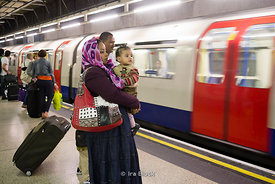 People waiting at Heathrow Terminals 1, 2, 3 station of London Underground's Piccadilly Line, London, UK.