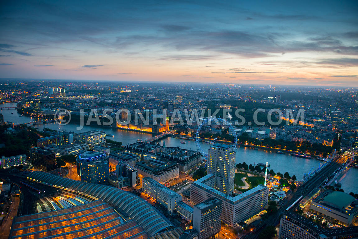 Dusk aerial view from overhead Waterloo Staion over the Shell Centre and Jubilee Gardens looking to Westminster, London.