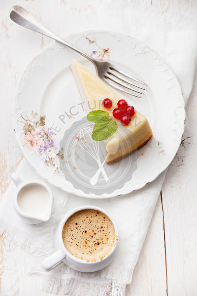 Cheesecake with red currant with coffee on plate