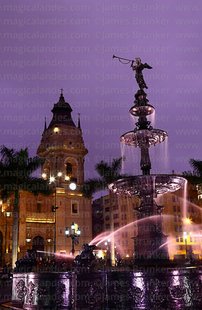 Fountain and tower of cathedral at sunset, Plaza de Armas, Lima, Peru
