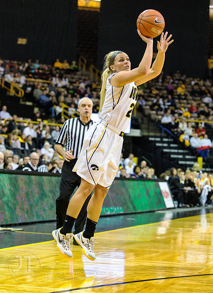 Iowa's Melissa Dixon (21) fires a three-point shot versus Purdue during the first half of play at Carver-Hawkeye Arena in Iow...
