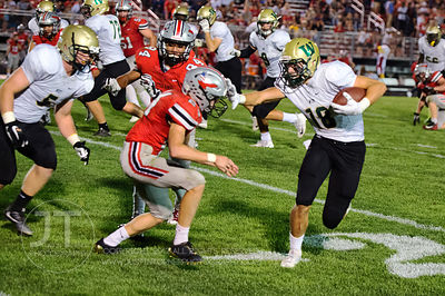 Iowa City West's Cole Mabry (18) pukes a juke on Iowa City High's Maxwell DePrenger (24) during the first half of play at Fra...
