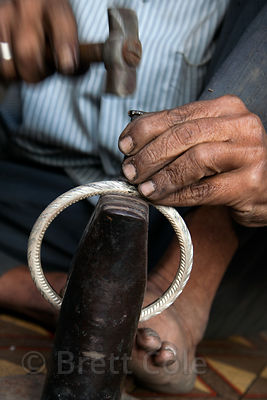Man making silver anklets in Jodhpur, Rajasthan, India