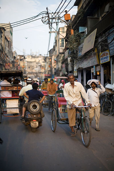 India - Delhi - A man preddles his rickshaw on the streets of Chawri Bazaar