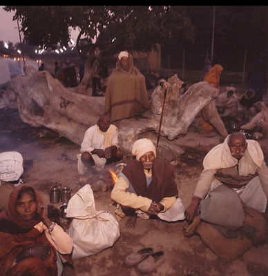 Pilgrims at their camp at dusk at the Kumbh Mela