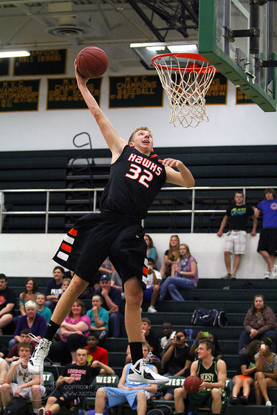 Cedar Rapids Prairie's MAtt MacDougall (32) participates in the slam dunk competition. The Northern All-Star team defeated th...