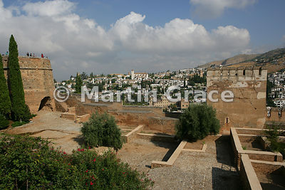 The Patio de la Madraza, Alhambra, with the Torre del Cubo (The Tub) to the left and the Torre de las Gallinas to the right, ...