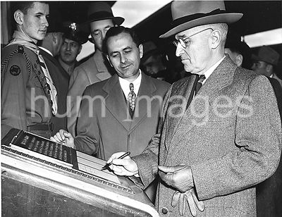 Photograph of President Harry S. Truman as He Signs the Guestbook of Freedom Train