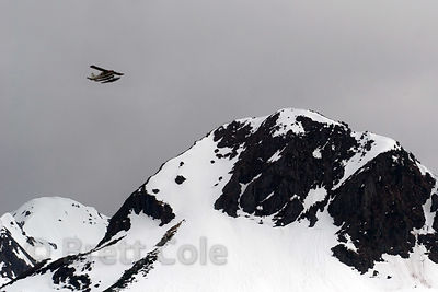Float plane flying over mountains near Cordova, Alaska