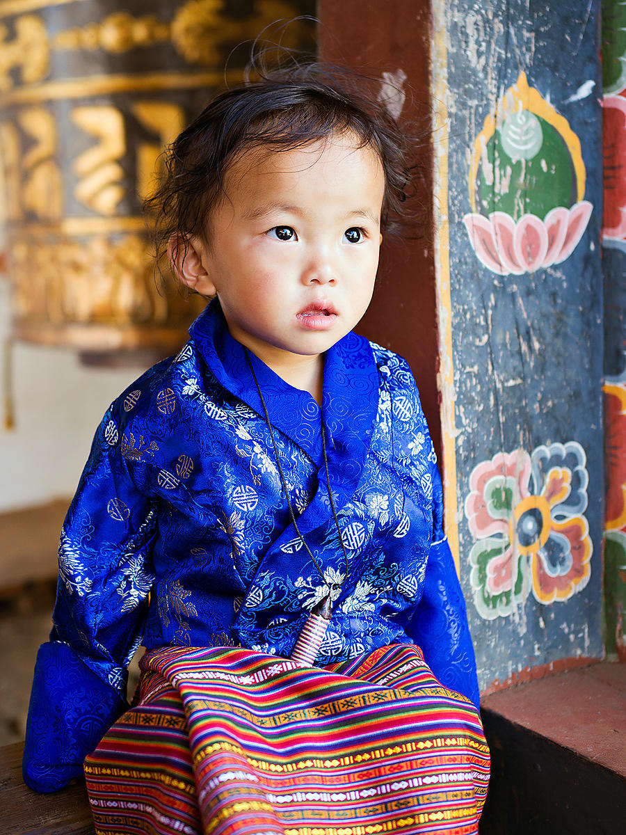 This portrait of a young bhutanese girl was taken in a monastery in Bhutan.