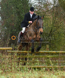 Johnny Greenall jumping a hunt jump in Holwell. The Belvoir Hunt at Hill Top Farm 1/12