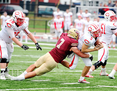 Coe College's Robbie Peters (7) sacks Central's QB Blaine Hawkins (3) during the first half of play at Clark Field in Cedar R...