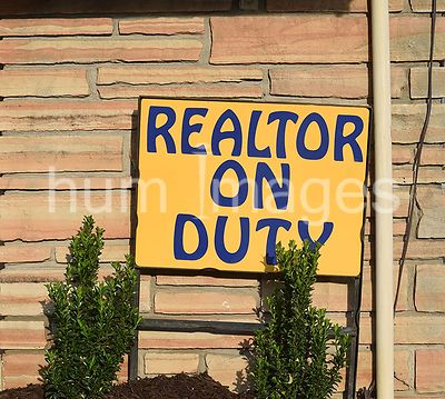 Yellow Realtor on Duty sign