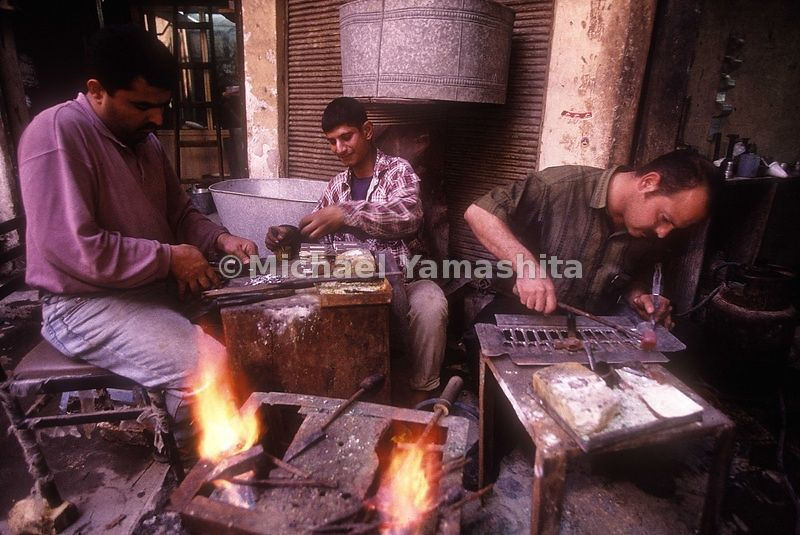 Metal smiths perform their craft in Badghdad, Iraq.