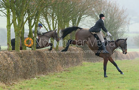jumping a hedge away from Sheepwash - The Belvoir Hunt at Sheepwash 31/12