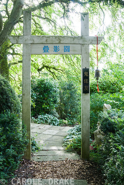 Chinese gateway marking entrance to garden of 10,000 Shadows planted with mostly non-Chinese plants, hence the vertical sign ...