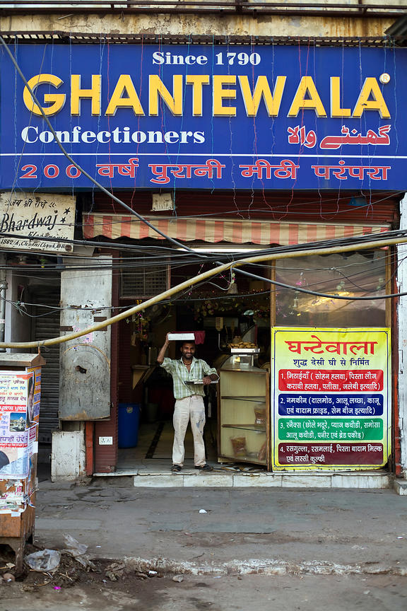 India - Delhi - Raj who delivers the sweets in the Ghantewallah Confectionary shop on Chadni Chowk