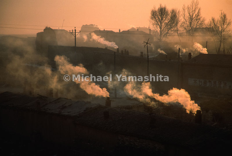 Coal fires burning at dawn in the walled city of Deshengpu, China