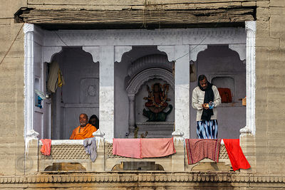 A man meditates along the Ganges River, Varanasi, India.
