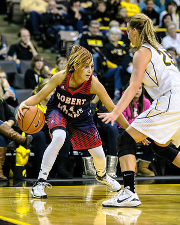 Robert Morris' Ashley Ravelli (14) dribbles against Iowa's Kali Peschel (25) during the first half of play at Carver-Hawkeye ...