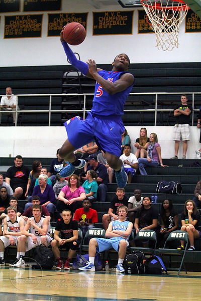 Davenport Central's Demetrius Butler participates in the slam dunk competition. The Northern All-Star team defeated the South...