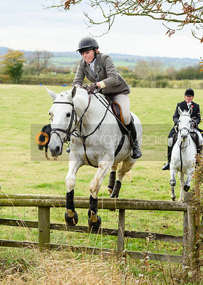 Rose Weatherby jumping onto Bruce's Lane. The Cottesmore Hunt at Somerby