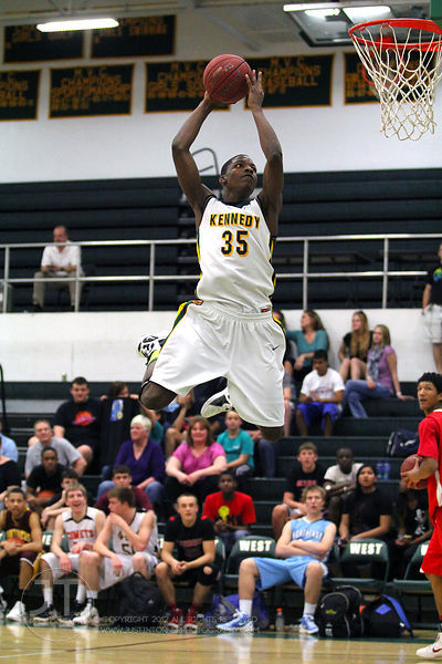 Cedar Rapids Kennedy's Josiah Coleman (35) participates in the slam dunk competition. The Northern All-Star team defeated the...