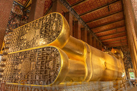 The huge feet of the Reclining Buddha of the Wat Pho temple complex in the Bangkok.  The Buddha that measures 46 metres long ...