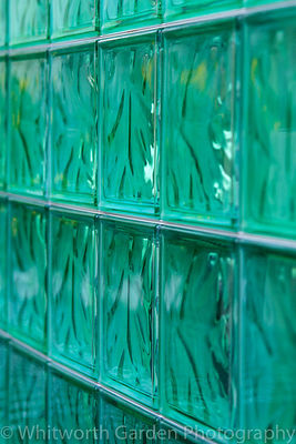 A wall created from green, glass bricks. © Rob Whitworth