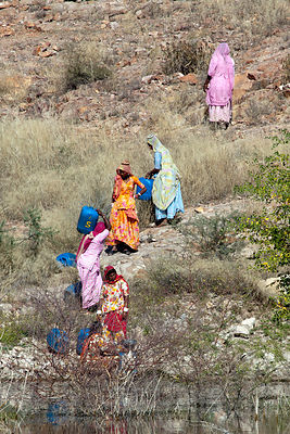 Women collect water from a small lake at the Jaswant Thada memorial, Jodhpur, Rajasthan, India