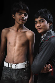 Two boys from Jodhpur, India photographed in front of their dark butcher shop. 100%% natural lighting and natural background,...
