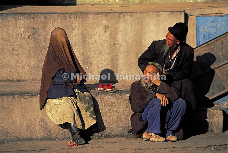 The veil worn by Uighur women is a simple shawl, often brown.