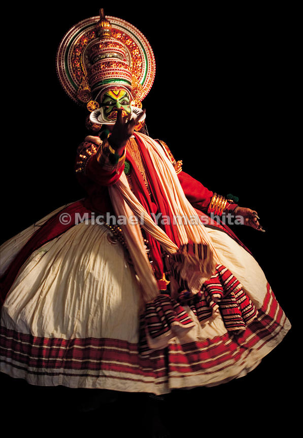 With elaborately carved headddresses and intricate costumes, Kathakali dramatizes stories form Hindu mythology.
