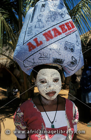 Makua girl with face mask. The mask is a moisterising extract from a tree bark. Ibo Island, Mozambique